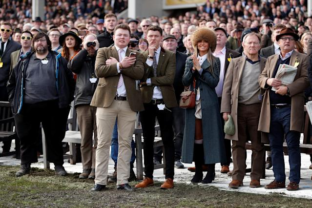 Horse Racing - Cheltenham Festival - Cheltenham Racecourse, Cheltenham, Britain - March 15, 2018 Racegoers look on during the 14:10 Pertemps Network Final Handicap Hurdle Action Images via Reuters/Andrew Boyers