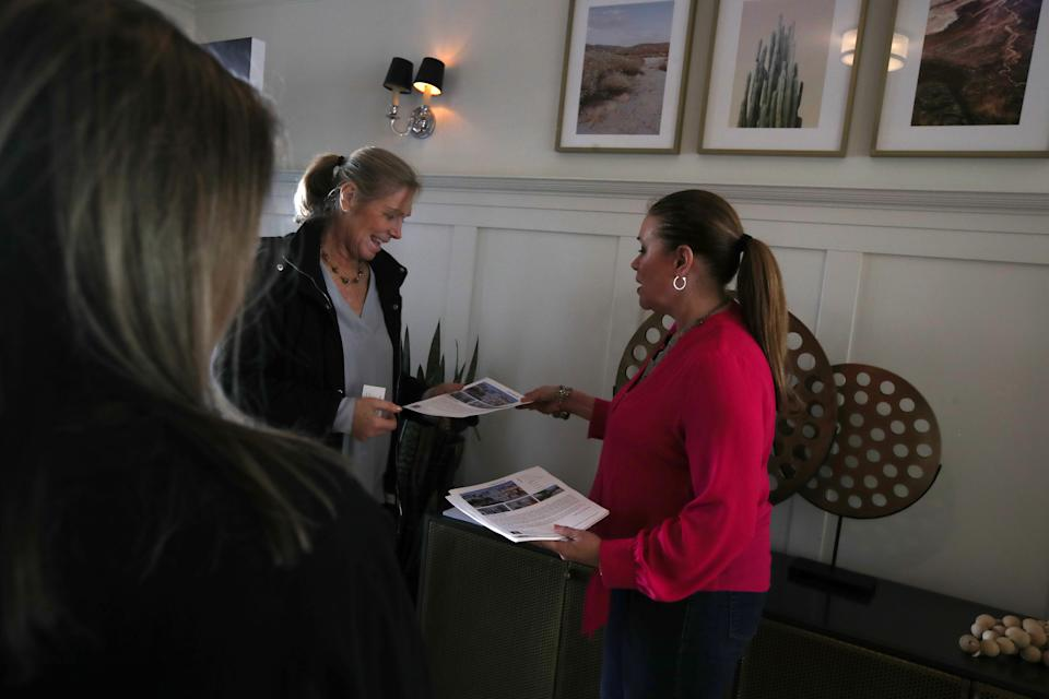 SAN FRANCISCO, CALIFORNIA - APRIL 16: Real estate agent Kristan Marie Lynch passes out fliers during a broker open house on April 16, 2019 in San Francisco, California. In the wake of several tech company IPOs, San Francisco is bracing for its already expensive real estate market to get even more expensive.  Workers for companies that are debuting on the stock market could become millionaires overnight and look to spend their new wealth on property. (Photo by Justin Sullivan/Getty Images)