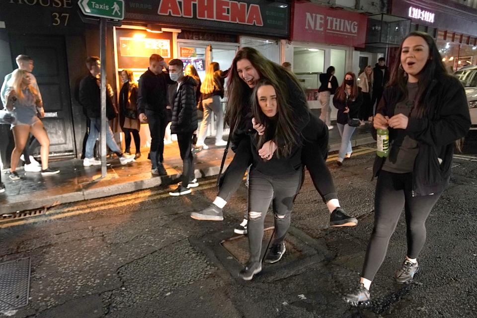 People out socialising in Newcastle city centre, ahead of the 10pm curfew that pubs and restaurants are subject to in order to combat the rise in coronavirus cases in England. Cities in northern England and other areas suffering a surge in Covid-19 cases may have pubs and restaurants temporarily closed to combat the spread of the virus.