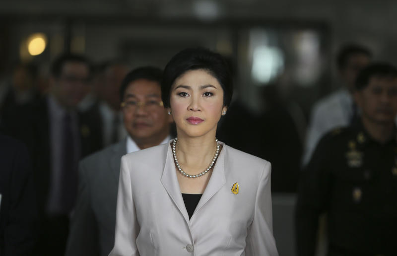 Thailand Prime Minister Yingluck Shinawatra arrives to talk to media after attending a Cabinet meeting in Bangkok, Thailand, Tuesday, Dec. 10, 2013. Shinawatra said Tuesday she would not resign ahead of national elections set for Feb. 2, despite opposition demands she step down as the caretaker head of government. (AP Photo /Manish Swarup)