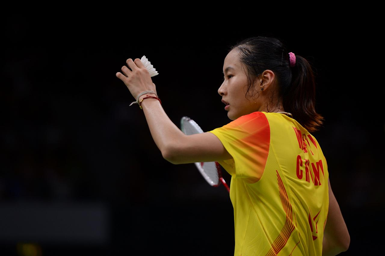 LONDON, ENGLAND - AUGUST 03:  Yihan Wang of China prepares to serve in the Women's Singles Badminton Semi-Final against Saina Nehwal of India on Day 7 of the London 2012 Olympic Games at Wembley Arena on August 3, 2012 in London, England.  (Photo by Michael Regan/Getty Images)