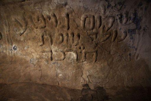 """Hebrew inscription that reads """"Shalom Guetta born here 1864"""" is seen on a wall inside one of the surviving synagogues in the Berber village of Yafran in western Libya on July 13. For centuries, Jews lived among the Berbers of Yafran, observing the Sabbath at the synagogue of Ghriba, but they suddenly left 63 years ago, and their land in Libya remains untouched"""
