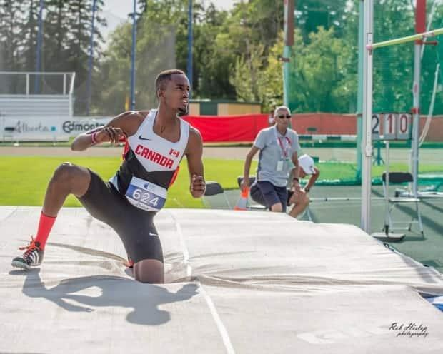 The family of 24-year-old Steve Nkusi, who represented Canada in high jump at the 2015 Junior Pan American Games, say he aspired to do charity work in Rwanda. He went missing after a swim at a St. Catharines, Ont., beach on Saturday. (Submitted by Sandrine Mugeni - image credit)