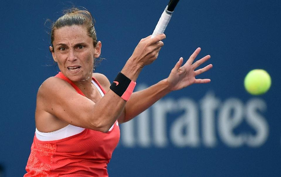 Roberta Vinci returns the ball to Serena Williams during their 2015 US Open Women's singles semifinal match in New York on September 11, 2015 (AFP Photo/Jewel Samad)