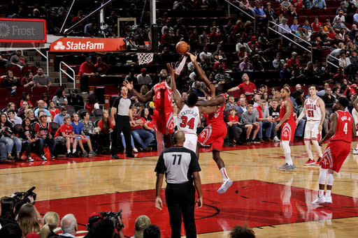 HOUSTON, TX - DECEMBER 1: James Ennis III #8 of the Houston Rockets shoots the ball against the Chicago Bulls on December 1, 2018 at the Toyota Center in Houston, Texas. (Photo by Bill Baptist/NBAE via Getty Images)