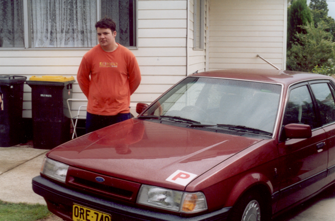 Brendon Gilson stands next to a car with red P-plates before he died in a car crash.