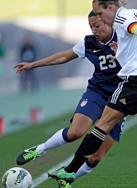 Christen Press, left, of the US, fights for the ball with Germany's Babet Peter during their Algarve Cup women's soccer final match Wednesday, March 13 2013, at the Algarve stadium outside Faro, southern Portugal.The US defeated Germany 2-0 in the final. (AP Photo/Armando Franca)