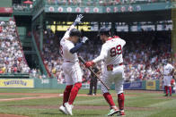 Boston Red Sox's Enrique Hernandez, left, celebrates with Alex Verdugo (99) after hitting a home run in the first inning of a baseball game against the New York Yankees, Sunday, June 27, 2021, in Boston. (AP Photo/Steven Senne)