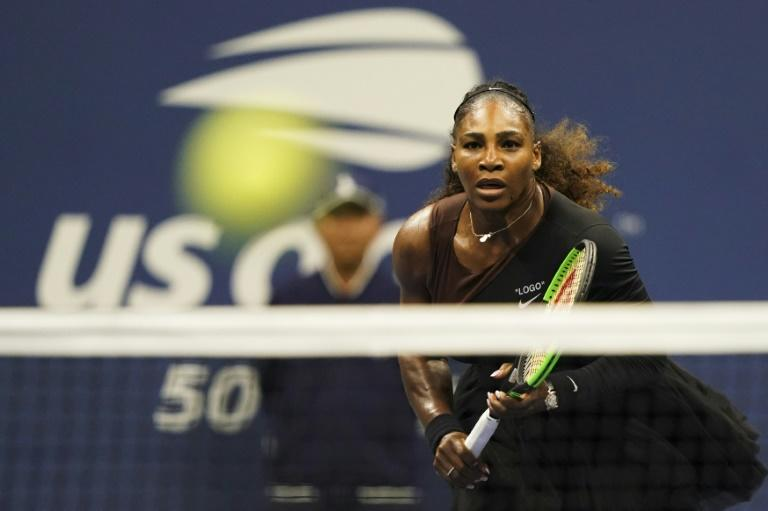 On song: Serena Williams on the way to a US Open third-round victory over her sister Venus on Friday