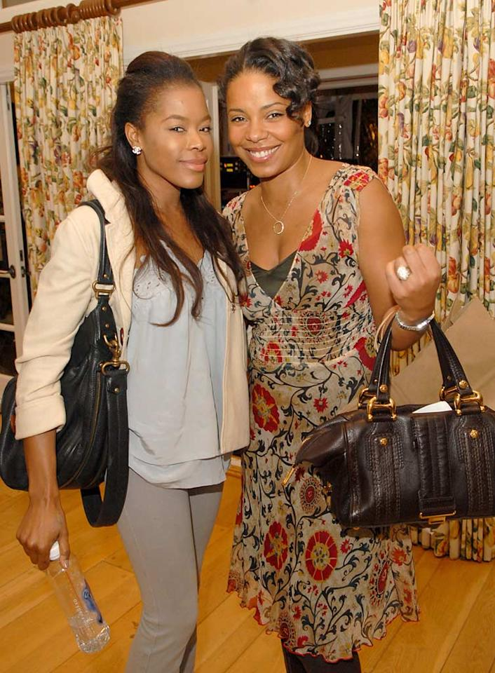 """""""Girlfriends'"""" Golden Brooks and """"Nip/Tuck's"""" Sanaa Lathan smile for the camera. Unfortunately, Sanaa appears to blend in with the curtains behind her. Michael Caulfield/<a href=""""http://www.wireimage.com"""" target=""""new"""">WireImage.com</a> - December 8, 2007"""