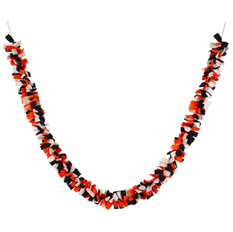 """<p>An alternative to tinsel, which gets beat up when you reuse it, this six-foot-long garland made of orange, black, and white strips of felt will last for ages. The saturated color and wooly material gives it a homespun feel (but, thank the ghouls, you didn't have to craft it yourself).</p> <p><b>To buy: </b>Ashland Halloween Colors Garland, $7 (originally $18), <a href=""""http://www.anrdoezrs.net/links/7876406/type/dlg/sid/RS%2CTheBestHalloweenGarlandsUnder%252420%2Ckholdefehr1271%2CHOL%2CIMA%2C680012%2C201910%2CI/https://www.michaels.com/6ft.-halloween-colors-garland-by-ashland/10596170.html"""" target=""""_blank"""">michaels.com</a>. </p>"""
