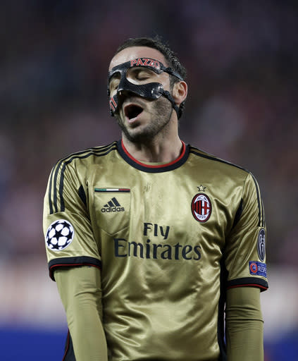 AC Milan's Giampaolo Pazzini reacts during a Champions League, round of 16, second leg, soccer match between Atletico Madrid and AC Milan at the Vicente Calderon stadium in Madrid, Tuesday March 11, 2014. AC Milan lost 1-4. (AP Photo/Paul White)