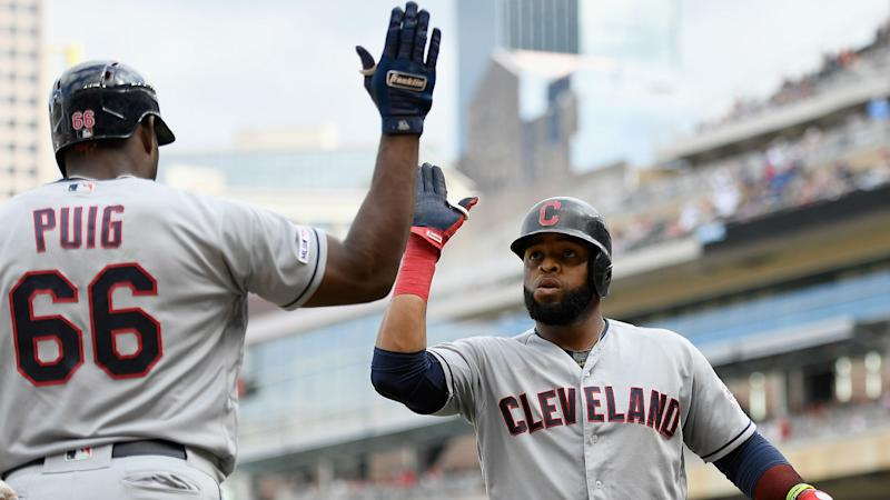 Santana's 10th-inning slam helps Indians tie Twins in AL Central race