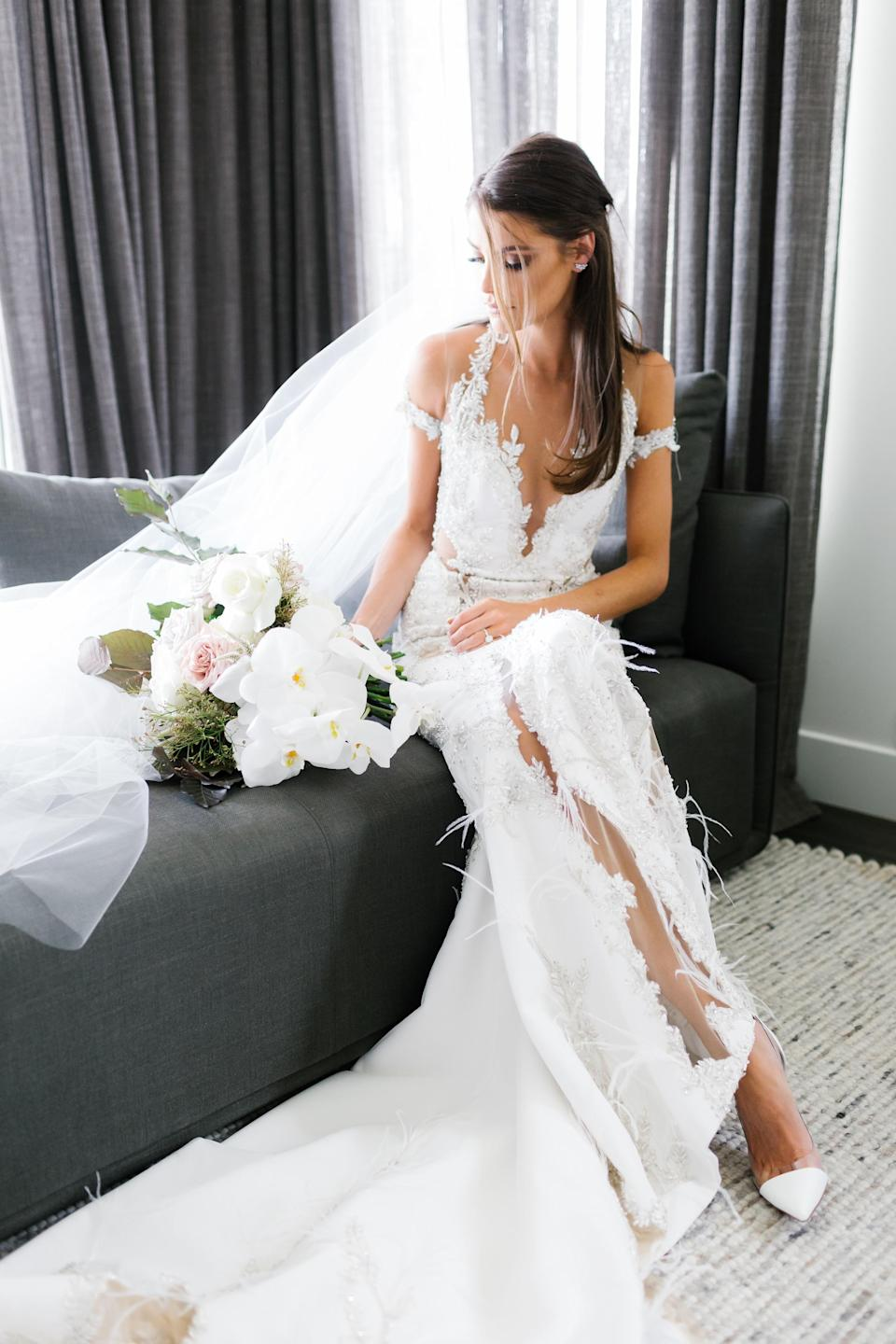 """Charlotte's gown was """"fully hand beaded with details in tiny mirror backed Swarovski crystals, thousands of both bugle and seed beads, hand embroidered floral stems using bullion thread and silk thread foliage"""". Photo: Chloe May"""