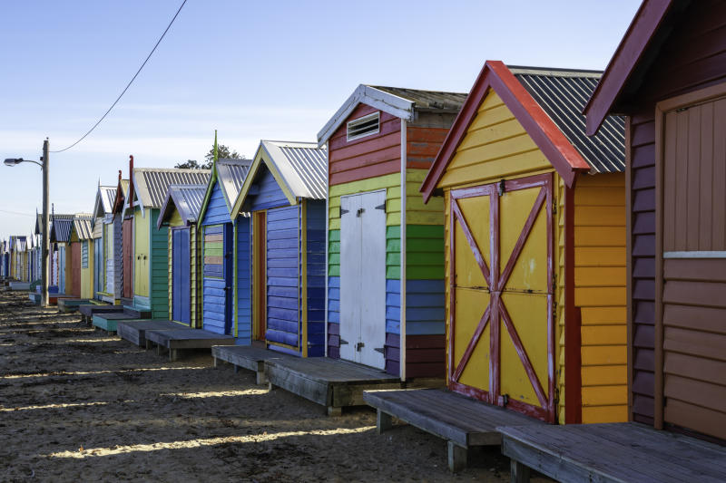Bright and colourful bathing huts at Brighton Beach on the outskirts of Melbourne, Australia