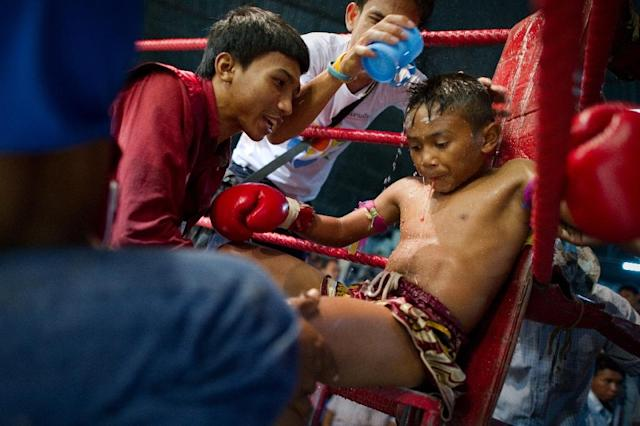 A bill to prevent minors aged under 12 from taking part in brutal Muay Thai boxing bouts is under consideration in Thailand (AFP Photo/NICOLAS ASFOURI)