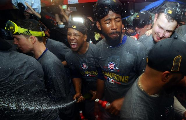 <p>Chicago Cubs players including Dexter Fowler celebrates in the clubhouse after defeating the Cleveland Indians in game seven of the 2016 World Series at Progressive Field. Mandatory Credit: Ken Blaze-USA TODAY Sports </p>