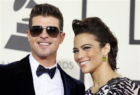 Robin Thicke and Paula Patton arrive at the 56th annual Grammy Awards in Los Angeles