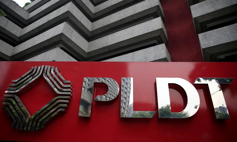 A logo of Philippine Long Distance Telephone Company (PLDT) is seen in front of their building in Makati city, metro Manila, Philippines May 30, 2016. REUTERS/Romeo Ranoco