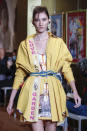 A model wears a creation as part of the Francesco Liberatore 2021 women's spring-summer ready-to-wear collection during the Milan's fashion week in Milan, Italy, Friday, Sept. 25, 2020. (AP Photo/Antonio Calanni)