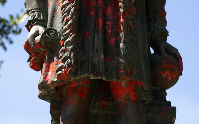 A statue of Christopher Columbus was discovered vandalised with red paint, in San Antonio, Texas (Eric Gay/AP)