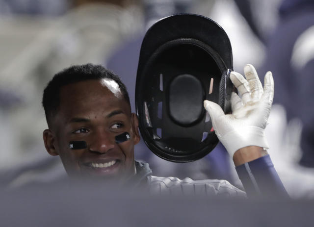 New York Yankees' Miguel Andujar reacts after hitting a solo home run against the Toronto Blue Jays during the fourth inning of a baseball game, Friday, April 20, 2018, in New York. (AP Photo/Julie Jacobson)