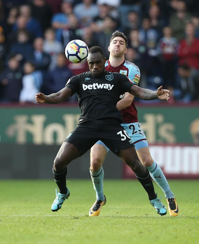 BURNLEY, ENGLAND - OCTOBER 14: West Ham United's Michail Antonio and Burnley's Stephen Ward during the Premier League match between Burnley and West Ham United at Turf Moor on October 14, 2017 in Burnley, England. (Photo by Rob Newell - CameraSport via Getty Images)
