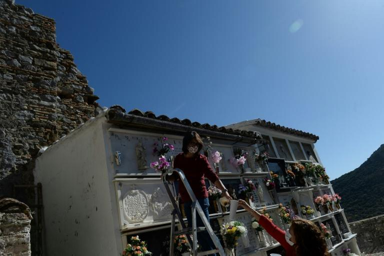 As cases have spiralled in cities, Madrid funeral workers have downed tools saying they need more staff