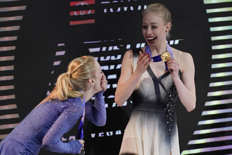 Second-place Amber Glenn, left, and first-place Bradie Tennell smile after receiving their medals at the U.S. Figure Skating Championships, Friday, Jan. 15, 2021, in Las Vegas. (AP Photo/John Locher)