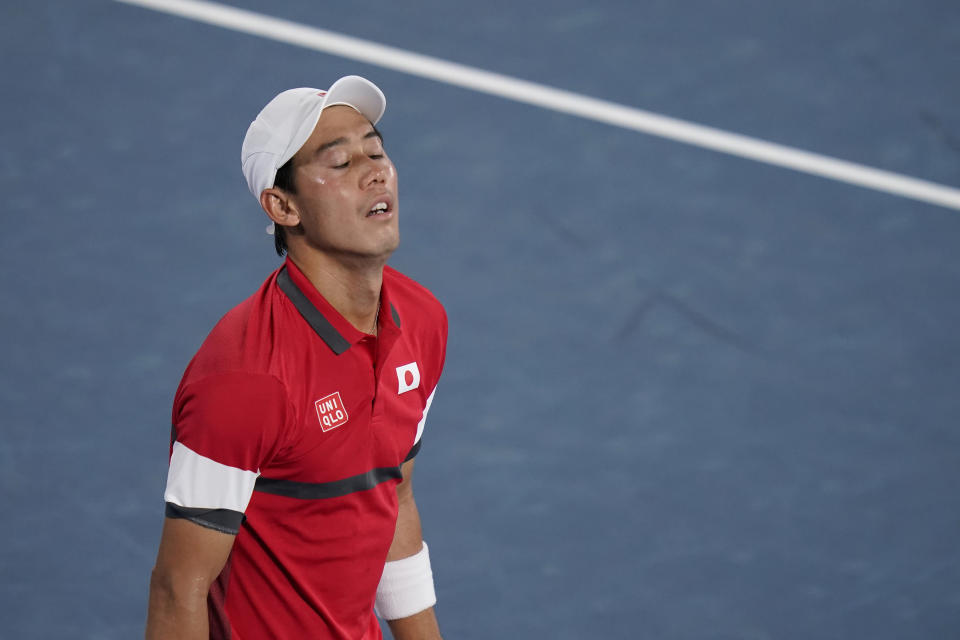 Kei Nishikori, of Japan, reacts while playing Novak Djokovic, of Serbia, during the quarterfinals of the tennis competition at the 2020 Summer Olympics, Thursday, July 29, 2021, in Tokyo, Japan. (AP Photo/Seth Wenig)