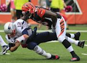 New England Patriots quarterback Tom Brady (12) is sacked by Cincinnati Bengals defensive end Wallace Gilberry (95) in the first half of an NFL football game, Sunday, Oct. 6, 2013, in Cincinnati. (AP Photo/Tom Uhlman)