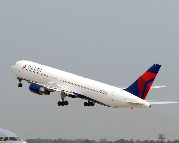 A Delta Air Lines 767-400ER jet taking off