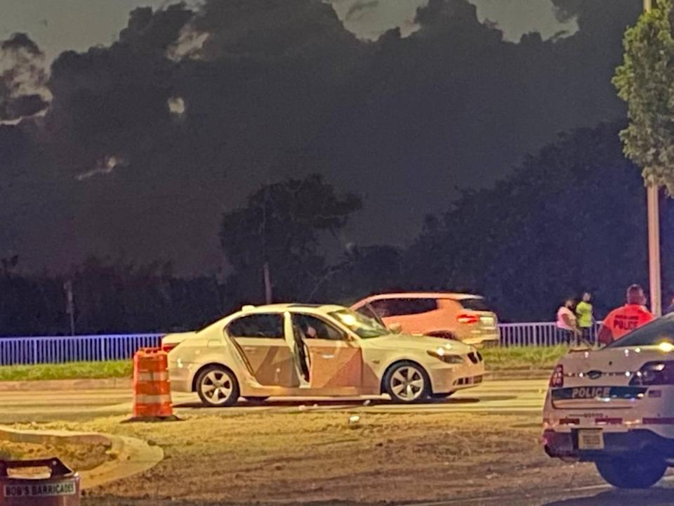 A white BMW is parked on the side of U.S. 1 at the intersection of Southwest 137th Avenue in Princeton Tuesday night, Feb. 23, 2021. The occupants of the car were involved in a shootout with people in another car, according to Miami-Dade County police.