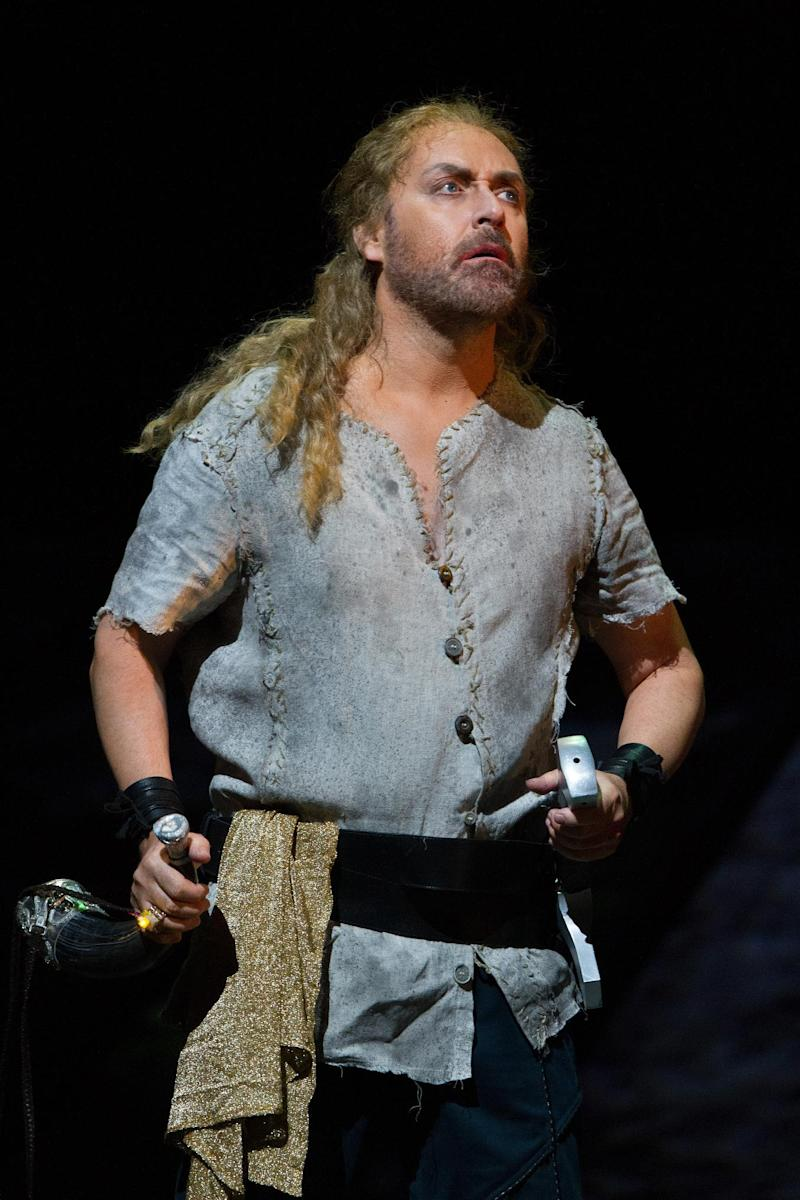 "This April 18, 2013 photo provided by the Metropolitan Opera shows Lars Cleveman as Siegfried in a dress rehearsal of Wagner's ""Götterdämmerung,"" at the Metropolitan Opera in New York. The Swedish tenor Lars Cleveman took over the character from Jay Hunter Morris and appeared in the title role of ""Siegfried"" Wednesday, May 8, in the third opera of the ""Ring"" cycle,  proving himself to be a solid if unspectacular successor.(AP Photo/Metropolitan Opera, Marty Sohl)"