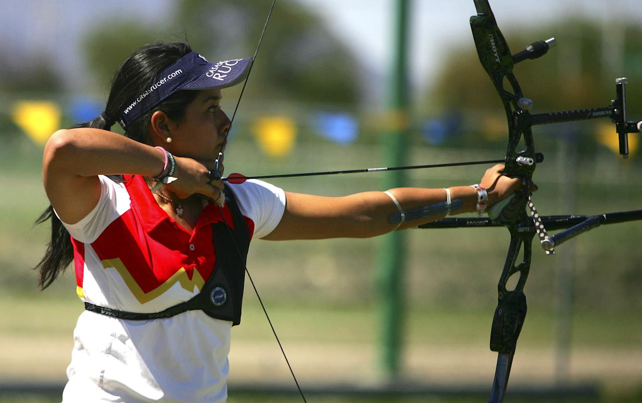 MONTERREY, MEXICO - MARCH 12:  Archer Mariana Avitia of Mexico in action during the selective Grand Prix of Archery for the Youth Olympic Games at the sport center of UANL on March 12, 2010 in Monterrey, Mexico. (Photo by Alfredo Lopez/Jam Media/LatinContent/Getty Images)