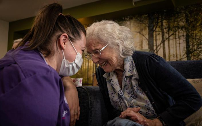 Jacie Whittaker, team leader, with Gloria, 86, at Normanby House Residential Home, Scarborough - Simon Townsley