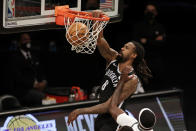 Brooklyn Nets center DeAndre Jordan dunks during the second half of an NBA basketball game against the Milwaukee Bucks, Monday, Jan. 18, 2021, in New York. (AP Photo/Adam Hunger)