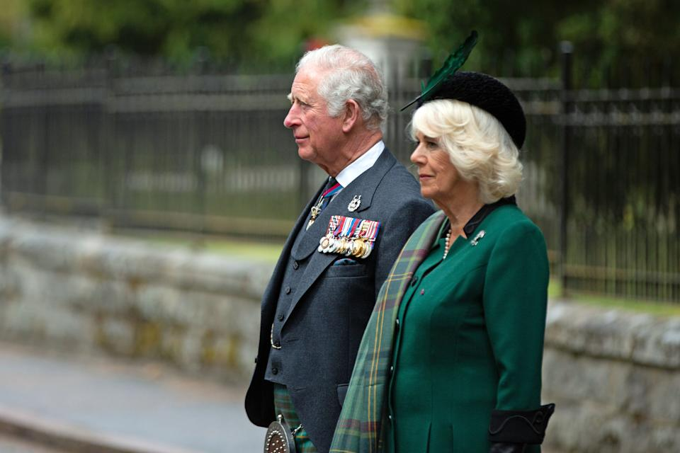 Britain's Prince Charles, Prince of Wales (L) and Britain's Camilla, Duchess of Cornwall (R) observe a 2 minute silence to mark the 75th anniversary of VE Day (Victory in Europe Day), the end of the Second World War in Europe at the Balmoral War Memorial in central Scotland on May 8, 2020. (Photo by Amy Muir / POOL / AFP) (Photo by AMY MUIR/POOL/AFP via Getty Images)