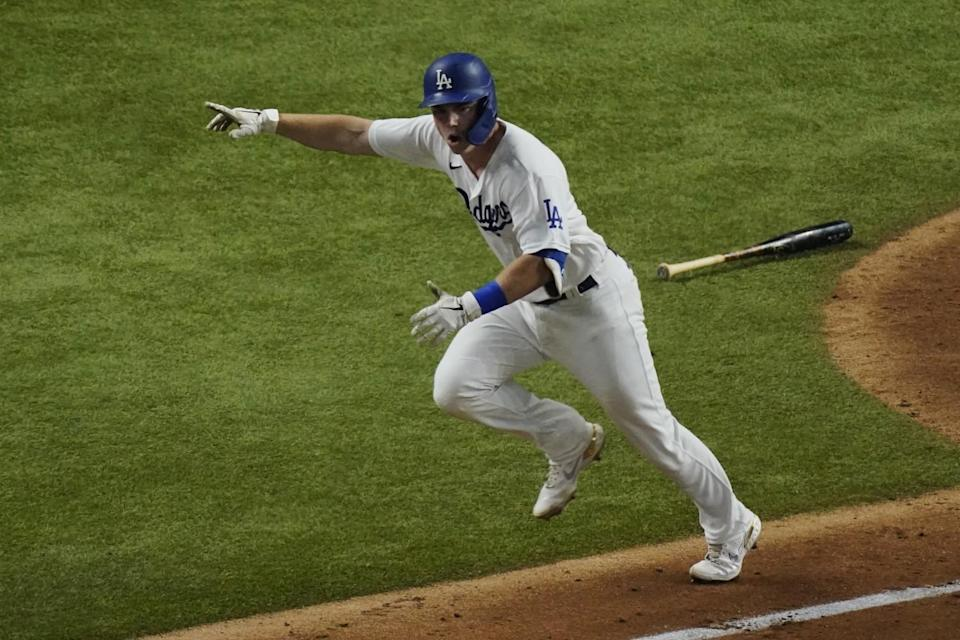 Dodgers catcher Will Smith celebrates after hitting a two-run single against the Atlanta Braves in Game 7 of the NLCS.