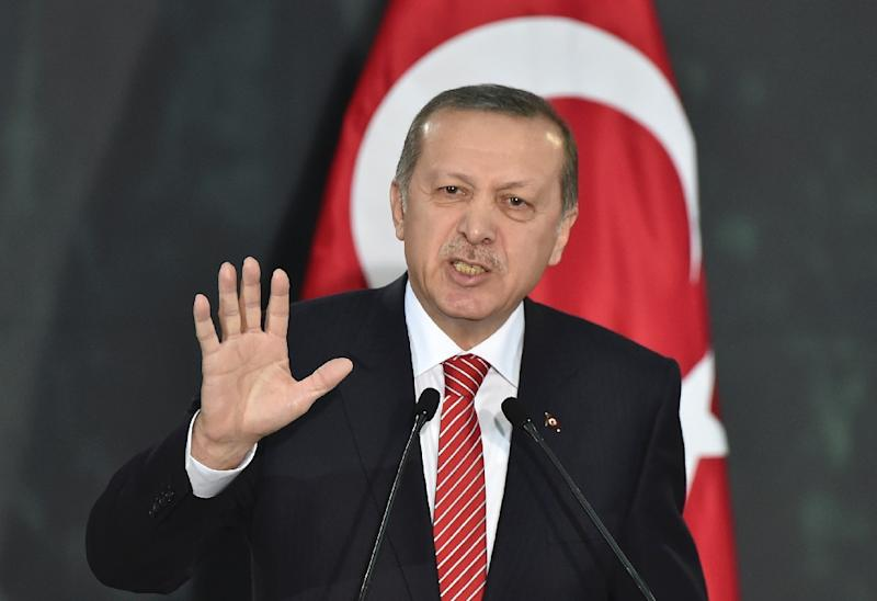 Two ex-policemen have been arrested on suspicion of bugging Turkish President Recep Tayyip Erdogan