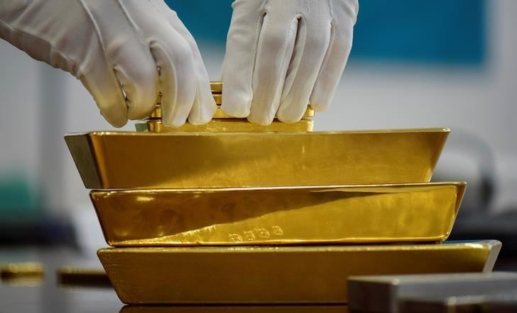 An employee places gold bars in the Kazakhstan's National Bank vault in Almaty