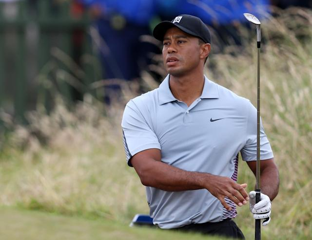 Tiger Woods of the US plays a shot on the practice chipping green ahead of the British Open Golf championship at the Royal Liverpool golf club, Hoylake, England, Wednesday July 16, 2014. The British Open Golf championship starts Thursday July 17. (AP Photo/Scott Heppell)