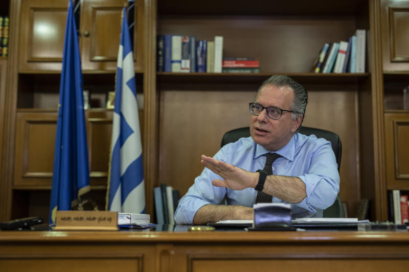 Alternate Minister for immigration policy in the ministry of Citizen's Protection of Greece, George Koumoutsakos speaks to the Associated Press during an interview , in Athens, on Friday, Sept. 27, 2019. Authorities in Greece say seven people have died Friday after a boat carrying migrants sank in the eastern Aegean Sea. (AP Photo/Petros Giannakouris)
