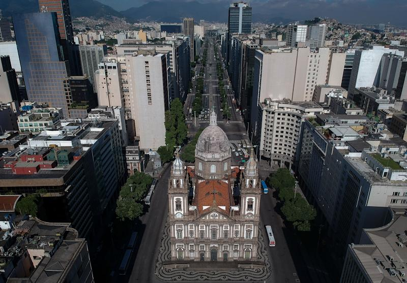 Aerial view of the Candelaria church and the empty Presidente Vargas avenue in downtown Rio de Janeiro, Brazil on March 25, 2020, during the outbreak of the new coronavirus. (Photo by MAURO PIMENTEL / AFP) (Photo by MAURO PIMENTEL/AFP via Getty Images)