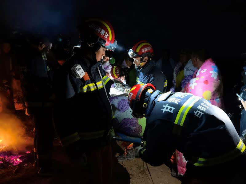 Rescue workers work at the site of the accident where extreme cold weather killed participants of an 100-km ultramarathon race in Baiyin