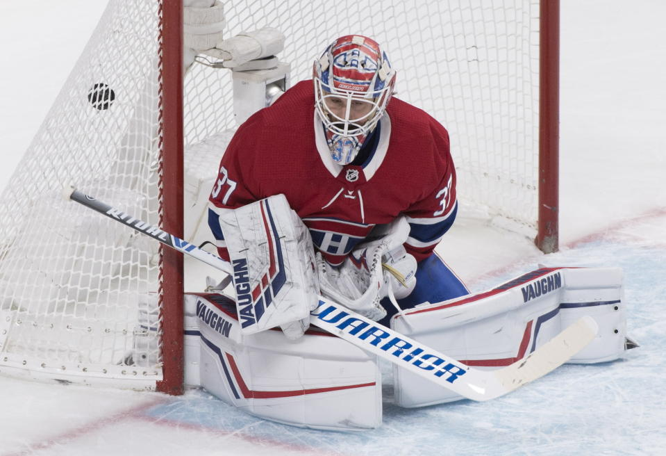 Montreal Canadiens goaltender Keith Kinkaid gives up a goal to New Jersey Devils' Kyle Palmieri during overtime in an NHL hockey game in Montreal, Saturday, Nov. 16, 2019. (Graham Hughes/The Canadian Press via AP)