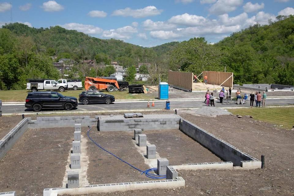 Construction begins on a 15-home project by the nonprofit, Housing Development Alliance in Hazard, Ky., Tuesday, May 11, 2021. The subdivision will be named after University of Kentucky professor and writer Gurney Norman who spend his childhood in Allais, outside of Hazard.