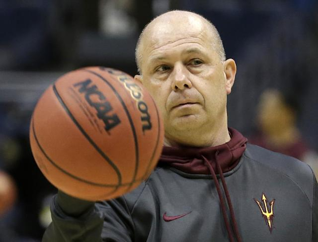 Arizona State head coach Herb Sendek passes the ball during a practice session for their NCAA college basketball tournament game Wednesday, March 19, 2014, in Milwaukee. Arizona State plays Texas State on Thursday. (AP Photo/Morry Gash)