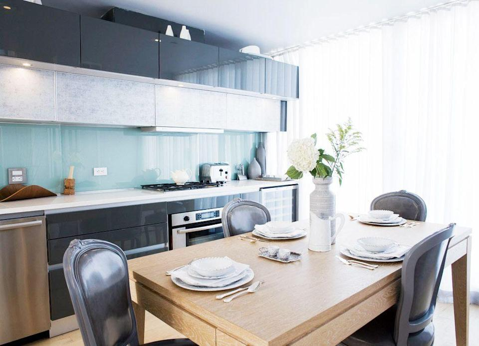 <p>Subway tile isn't your only backsplash option. Danielle Colding used a glass backsplash for a shinier, more modern and cosmopolitan touch in this city apartment. It goes perfectly with the lacquered cabinets. </p>