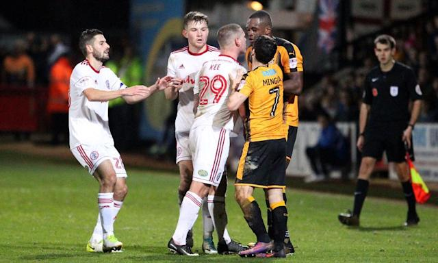 "<span class=""element-image__caption"">Tempers flare between Uche Ikpeazu of Cambridge United and Billy Kee.</span> <span class=""element-image__credit"">Photograph: TGSPhoto/Rex/Shutterstock</span>"
